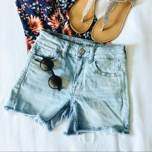 Light wash high waisted distressed jean shorts